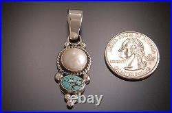 #8 Spiderweb Turquoise and Pearl Pendant by Erick Begay TO11G
